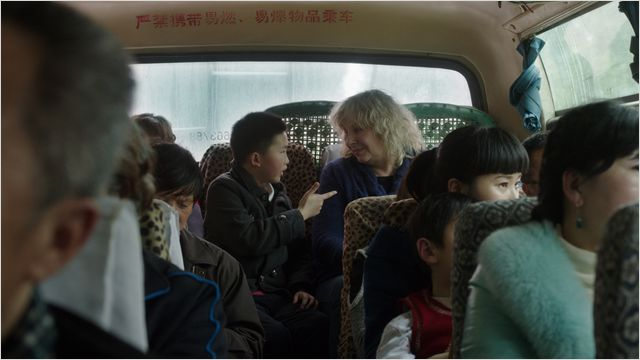 Leçon de chinois à l'arrière d'un autocar