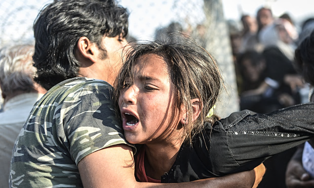 A la frontière entre la Syrie et la Turquie. Photo The Guardian